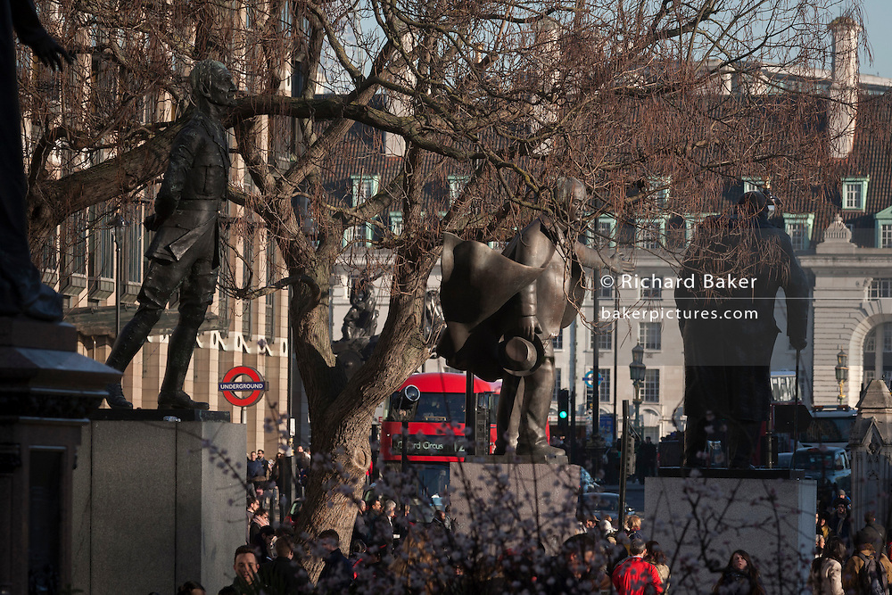 The three statues of South African President  Jan Smuts Lloyd-George And Churchill on 18th January 2017, in Parliament Square, London England. On the left is Field Marshal Jan Christiaan Smuts was a prominent South African and British Commonwealth statesman, military leader and philosopher. In the middle is David Lloyd George 1st Earl Lloyd-George of Dwyfor, OM, PC was a British Liberal politician and statesman. And on the right is Winston Churchill was a British wartime Prime Minister.