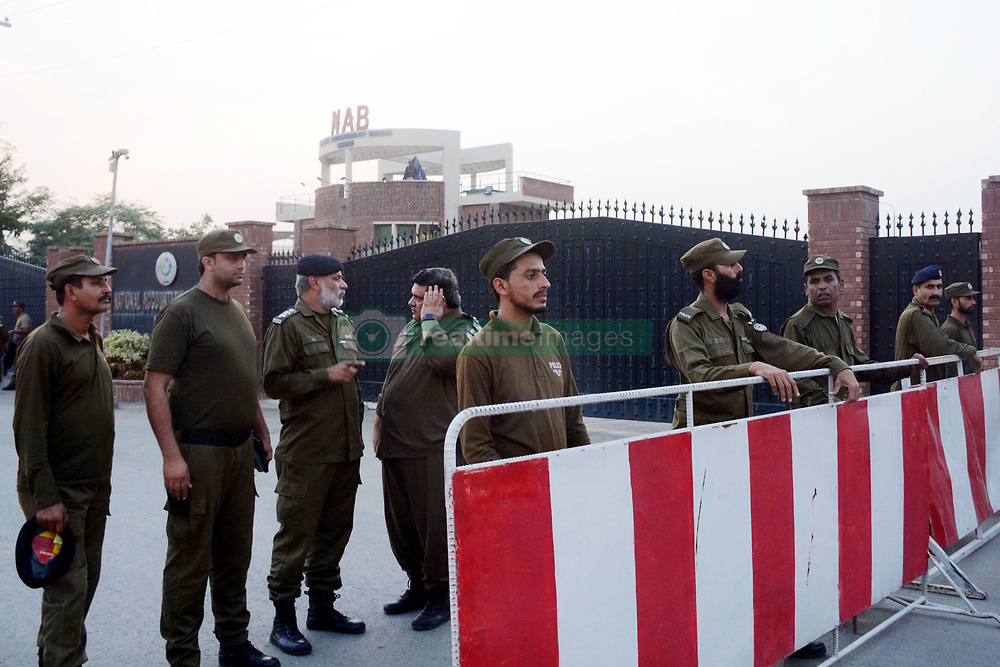 """October 5, 2018 - Lahore, Punjab, Pakistan - Police officers arrive to take positions for security at the office of National Accountability Bureau(NAB) following the opposition leader Shahbaz Sharif arrest, in Lahore on October 05, 2018. Pakistan's anti-graft body announced that it had arrested the country's opposition leader"""" former Chief Minister Punjab and Pakistan Muslim League-Nawaz (PML-N) President Shahbaz Sharif, over his alleged links to a multi-million dollar Ashiana Housing Scheme. officials said, the latest corruption allegation against the Sharif political dynasty that was ousted from power by ex-cricketer Imran Khan in elections this summer (Credit Image: © Rana Sajid Hussain/Pacific Press via ZUMA Wire)"""