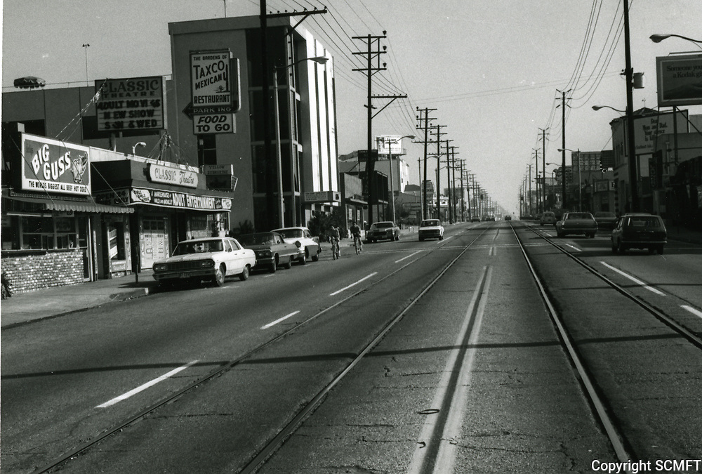 1972 Looking east on Santa Monica Blvd. from Sweetzer St. Streetcar tracks in the street