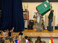 "Woodland Heights Elementary School mascot ""Whiskers"" arrived via special delivery by Principal Johnson during Thursday's assembly on PBIS (Positive Behavioral Intervention Supports).  (Karen Bobotas/for the Laconia Daily Sun)"