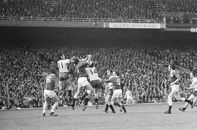 Players on both teams jump to catch the ball as Galway seizes possession during the All Ireland Senior Gaelic Football Championship Final Dublin V Galway at Croke Park on the 22nd September 1974. Dublin 0-14 Galway 1-06.