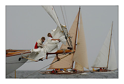 The bowmen on Moonbeam IV, change a headsail as they approach the South end of Cumbrae on the first day's racing. Mikado and Clio sit to windward...The largest gathering of classic yachts designed by William Fife returning to their birth place on the Clyde to participate in the 2nd Fife Regatta.  Yachts from around the world participated in the event which honoured the skills of Yacht Designer Wm Fife, and his yard in Fairlie, Scotland...Marc Turner / PFM Pictures