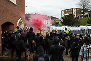 A smoke bombs held aloft outside a church on the front line as Anti Facist demonstrators marching through Dover clash with a facist demonstration also taking place in the port town. 30th January 2016