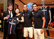 BEIJING, CHINA - JULY 31: (CHINA OUT) <br /> <br /> Football Players Of Paris Saint-Germain Football Club Attends Commercial Activity In Beijing<br /> <br /> Football players Gregory van der Wiel (R2) and Marcos Aoas Correa (R1) of Paris Saint-Germain Football Club attends a commercial activity of the brand Paris Saint-Germain on July 31, 2014 in Beijing, China.<br /> ©Exclusivepix