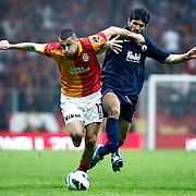 Galatasaray's Burak Yilmaz (L) during their Turkish Super League soccer match Galatasaray between IBBSpor at the AliSamiyen Spor Kompleksi TT Arena at Seyrantepe in Istanbul Turkey on Saturday, 30 March 2013. Photo by Aykut AKICI/TURKPIX