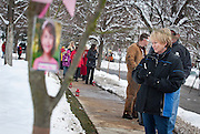 Karen Crompton looks at memorial trees during the community dedication of a grove of trees at the Salt Lake City cemetery in remembrance of victims of the Newtown, Conn. shootings, Thursday, Dec. 27, 2012.