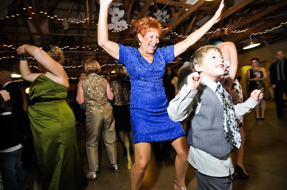 Everyone dancing at a wedding reception at the Audubon Center at Mill Grove, PA.
