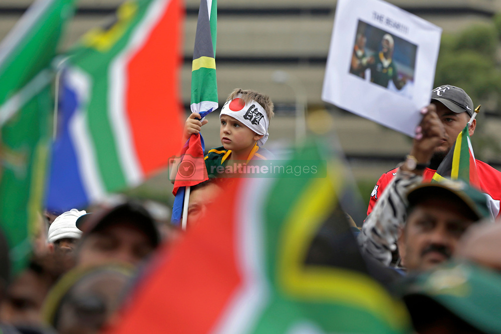Monday 11th November 2019.<br /> City Hall, Grand Parade,<br /> And City Centre, Cape Town,<br /> Western Cape,<br /> South Africa.<br /> <br /> SPRINGBOKS CELEBRATE WINNING THE RUGBY WORLD CUP CHAMPIONSHIP IN 2019 WITH A COUNTRYWIDE VICTORY TOUR!<br /> <br /> SPRINGBOKS RUGBY WORLD CUP VICTORY TOUR CAPE TOWN!<br /> <br /> A young boy wearing a Japanese headband waits with thousands of other excited fans on Cape Town's Grand Parade for the Springboks to arrive.<br /> <br /> The reigning Rugby World Cup Champions namely the South African Springbok Rugby Team, celebrates winning the Webb Ellis Cup during the International Rugby Football Board Rugby World Cup Championship held in Japan in 2019 with their Victory Tour that culminated in the final city tour taking place in Cape Town. Thousands of South African fans filled the streets of the city all trying their best to show their support for their beloved Springboks and to celebrate them winning the Rugby World Cup for the third time. South Africa previously won the Rugby World Cup in 1995, 2007 and now again in 2019. South African Springbok Captan Siya Kolisi took the opportunity to speak to the gathered crowd about how something like this brings unity and that we should live together as a nation that practices what is known as ubuntu. Ubuntu is a quality that includes the essential human virtues of compassion and humanity. This image taken in Cape Town on Monday 11th November 2019.<br /> <br /> This image is the property of Seven Bang Media Group (Pty) Ltd, hereinafter referred to as SBM.<br /> <br /> Picture By: SBM / Mark Wessels. (11/11/2019).<br /> +27 (0)61 547 2729<br /> mark@sevenbang.com<br /> www.sevnbang.com<br /> <br /> Copyright © SBM. All Rights Reserved.
