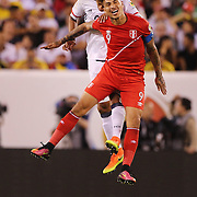 EAST RUTHERFORD, NEW JERSEY - JUNE 17: Jose Paolo Guerrero #9 of Peru is challenged by Jeison Murillo #22 of Colombia during the Colombia Vs Peru Quarterfinal match of the Copa America Centenario USA 2016 Tournament at MetLife Stadium on June 17, 2016 in East Rutherford, New Jersey. (Photo by Tim Clayton/Corbis via Getty Images)