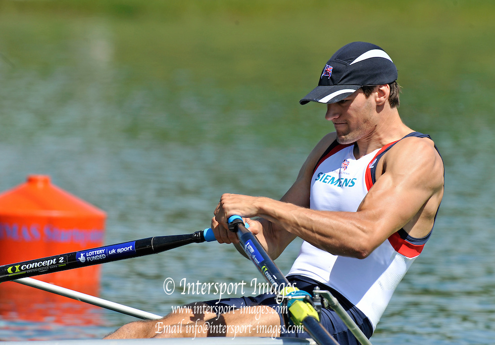 Munich, GERMANY,  Friday morning heats, GBR2 M1X. Graeme THOMAS. 2012 FISA World Cup III on the Munich Olympic Rowing Course,  Friday   15/06/2012. [Mandatory Credit Peter Spurrier/ Intersport Images]
