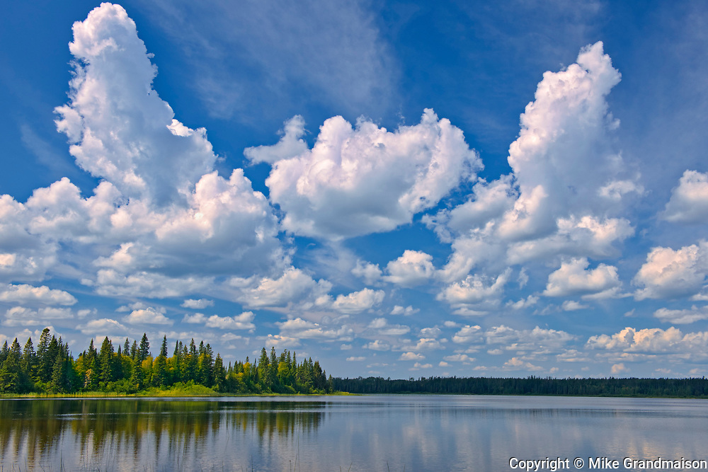 CLouds reflected in Burnfield Lake<br />Obatanga Provincial Park<br />Ontario<br />Canada