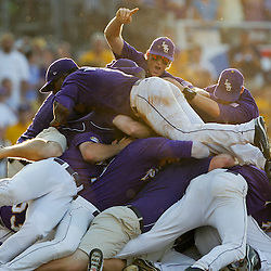 06 June 2009:  D.J. LeMahieu signals number one as he dives on top of the dogpile as players celebrate following a 5-3 victory by the LSU Tigers over the Rice Owls in game two of the NCAA baseball College World Series, Super Regional played at Alex Box Stadium in Baton Rouge, Louisiana. The Tigers with the win advance to next week's College Baseball World Series in Omaha, Nebraska.