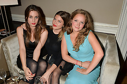 Left to right, LILY ROBINSON, REBECCA HOFFNUNG and POSY WOOD at the Tatler Little Black Book Party held at Home House Private Member's Club, Portman Square, London supported by CARAT on 6th November 2014.
