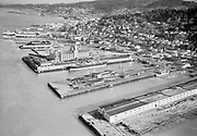 "Ackroyd 02513-5. ""Portland Stevedoring Co. aerials of S. S. Eitoku Maru & docks at Astoria, Oregon. November 7, 1950"""