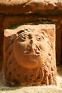 Norman Romanesque exterior corbel no 14 - sculpture of a head, half man half lion. The Norman Romanesque Church of St Mary and St David, Kilpeck Herefordshire, England. Built around 1140 .<br /> <br /> Visit our MEDIEVAL PHOTO COLLECTIONS for more   photos  to download or buy as prints https://funkystock.photoshelter.com/gallery-collection/Medieval-Middle-Ages-Historic-Places-Arcaeological-Sites-Pictures-Images-of/C0000B5ZA54_WD0s