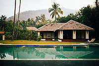Neriamangalam, India -- February 17, 2018: A view of the pool and dining area of the River House Resort on the Periyar River.