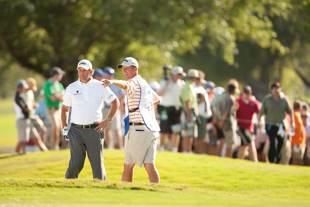 """DORAL, FL - MARCH 15:  Phil Mickelson and his caddie, Jim """"Bones"""" MacKay, discuss his shot during the fourth round of the 2009 WGC-CA Championship at Doral Golf Resort and Spa in Doral, Florida on Sunday, March 15, 2009. (Photograph by Darren Carroll) *** Local Caption *** Phil Mickelson;Jim MacKay"""