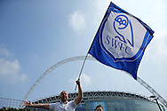a Sheffield Wednesday fan waving his flag outside Wembley Stadium before k/o. Skybet football league Championship play off final match, Hull city v Sheffield Wednesday at Wembley Stadium in London on Saturday 28th May 2016.<br /> pic by John Patrick Fletcher, Andrew Orchard sports photography.