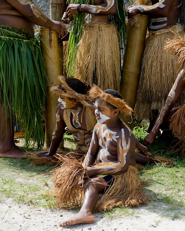 Young dancers await their turn to put on a show for cruise ship passengers on Isle of Pines in New Caledonia.