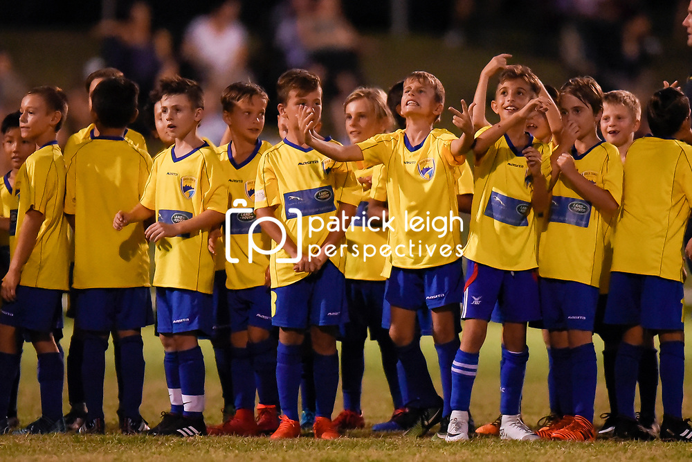 BRISBANE, AUSTRALIA - FEBRUARY 10: Gold Coast juniors wave to an aerial drone during the NPL Queensland Senior Mens Round 2 match between Gold Coast United and Brisbane Roar Youth at Station Reserve on February 10, 2018 in Brisbane, Australia. (Photo by Football Click / Patrick Kearney)