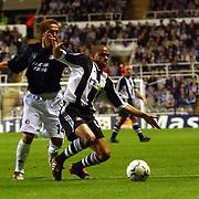 Newcastle United's Kieron Dyer fends off Shinji Ono of Feyenoord Rotterdam
