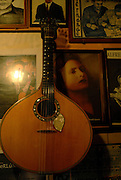 A Portuguese Guitar, the main instrument used in fado music and a picture of Amalia Rodrigues the legendary Fado diva. It's believed that the twelve-chord instrument is an evolution from arabic citar.