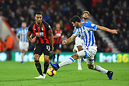 Callum Wilson (13) of AFC Bournemouth is challenged by Christopher Schindler (26) of Huddersfield Town during the Premier League match between Bournemouth and Huddersfield Town at the Vitality Stadium, Bournemouth, England on 4 December 2018.
