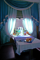 "This is the dining car on ""The Baikal"" the premium version of the Trans-Siberian that runs from Moscow to Irkutsk.  The Baikal has a better than usual dining car; depending on when you visit it and how well you tipped the waitress on your last visit.  Most passengers load up on snacks such as piroshkis and fruit on the platforms.   Still it can be fun to dine en route."