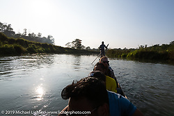 After riding from Pokhara to Chitwan, we had an interesting dugout canoe ride on the Northern Rapti River (home to crocodiles) through Chitwan National Park during Motorcycle Sherpa's Ride to the Heavens motorcycle adventure in the Himalayas of Nepal. Monday, November 11, 2019. Photography ©2019 Michael Lichter.