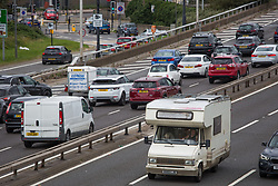 © Licensed to London News Pictures.  29/08/2021. London, UK. A large number of cars lined up on the A102 northbound in Greenwich, south London.  Drivers are being warned to avoid embarking on a bank holiday getaway. Photo credit: Marcin Nowak/LNP