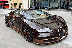 © Licensed to London News Pictures. 25/08/2016.  A fleet of supercars including a Bugatti Veyrom car with a value of over £1.8 million is parked in Knightsbridge.  Only three Rembrant  special editions were made. The cars are believed to be owned by Quatar Sheikh Khalifa bin Hamad bin Khalifa Al-Thani otherwise know as KHK. London, UK. Photo credit: Ray Tang/LNP