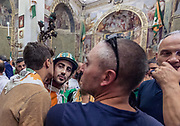"Italy, Siena, the Palio: Blessing of the horse and the jockey in each Contrada's parish church. The priest ends the mystical rite with a wish that sounds like an order: ""Go and come back victorious!"" . Selva contrada"