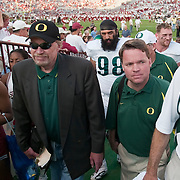 Nike founder and University of Oregon alumn exits the field after watching the Ducks play the Sooners. Knight and Nike are a major funding source for the Oregon Ducks football program.