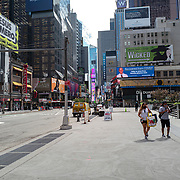 Broadway shows and city streets remain sparse to both visitors and traffic during the Phase 4 reopening on Monday, August 3, 2020 in New York, New York. Mayor de Blasio is asking travelers from 34 states and Puerto Rico, where COVID-19 infection rates are high, to quarantine for 14 days after arriving in the city.  (Alex Menendez via AP)