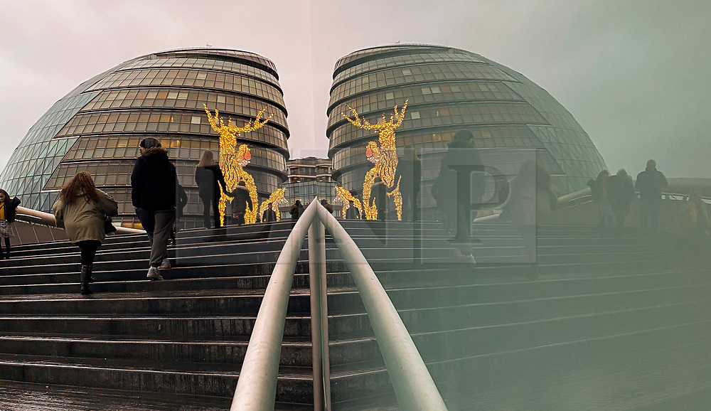 © Licensed to London News Pictures. 13/12/2020. London, UK. Reflection of City Hall and a reindeer Christmas decoration. Photo credit: Dinendra Haria/LNP