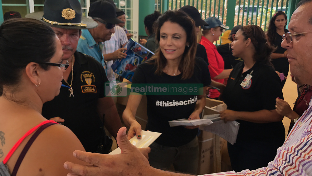 """Bethenny Frankel is seen here in a series of photos taken during her aid mission to Puerto Rico, which was ravaged by Hurricane Maria almost two weeks ago. The Real Housewives Of New York personality, who recently underwent surgery to remove skin cancer below her eye, has headed up a huge relief effort and chartered 10 planes to bring vital supplies to the island's stricken inhabitants. Frankel, 46, and her friends personally paid for the planes - the first four of which she managed to negotiate a fee of just under $20,000. As well as bringing medical and food supplies, Frankel alongside The Global Empowerment Mission flew back dozens of wounded women and children and cancer victims from local hospitals so they could get treatment in the United States. The Skinnygirl founder has used the power of social media to help network and find doctors back in the U.S. who could help. She explained: """"Twitter users literally saved babies lives by connecting me to a pediatric hospital allowing me to transport patients home [to the U.S.]. It is the most incredible tool in the world."""" Talking of the devastation she's witnessed on the U.S. territory island, Frankel said: """"This is a forgotten island. People have been living on their roofs for 13 days. It is like nothing I have ever seen. Peoples entire homes and cars are immersed in mud the likes I've never seen."""" The current death toll stands at 34, but is expected to rise as the humanitarian crisis continues. With an island-wide power outage and widespread lack of fuel, fears continue for residents on the island who need hospital treatment and regular care. Frankel went on: """"There is no color on the island. Every palm tree is rooted. This bitch hit every inch of this island. The low death toll is only counting what happened when it hit, but a storm happens more gradually than a hurricane. """"Now is when people are dying. They are starving. They are thirsty. They cannot communicate. They cannot bathe themselves. They"""