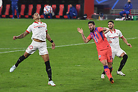 SEVILLE, SPAIN - DECEMBER 02: Diego Carlos of FC Sevilla and Olivier Giraud of Chelsea FC during the UEFA Champions League Group E stage match between FC Sevilla and Chelsea FC at Estadio Ramon Sanchez-Pizjuan on December 2, 2020 in Seville, Spain. (Photo by Juan Jose Ubeda/MB Media)