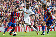 Jordan Ayew of Swansea city (c) skips away from Scott Dann of Crystal Palace ®.<br /> Premier League match, Crystal Palace v Swansea city at Selhurst Park in London on Saturday 26th August 2017.<br /> pic by Kieran Clarke, Andrew Orchard sports photography.