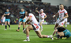 St Helens Saints' Jonny Lomax celebrates his try against Leeds Rhinos, during the Betfred Super League match at the Totally Wicked Stadium, St Helens.