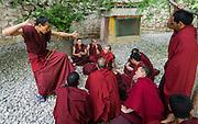 China, Tibet, Lhasa, Drepung Monastery, monk with Buddhist prayer beads (rosary) debating in Debating Courtyard
