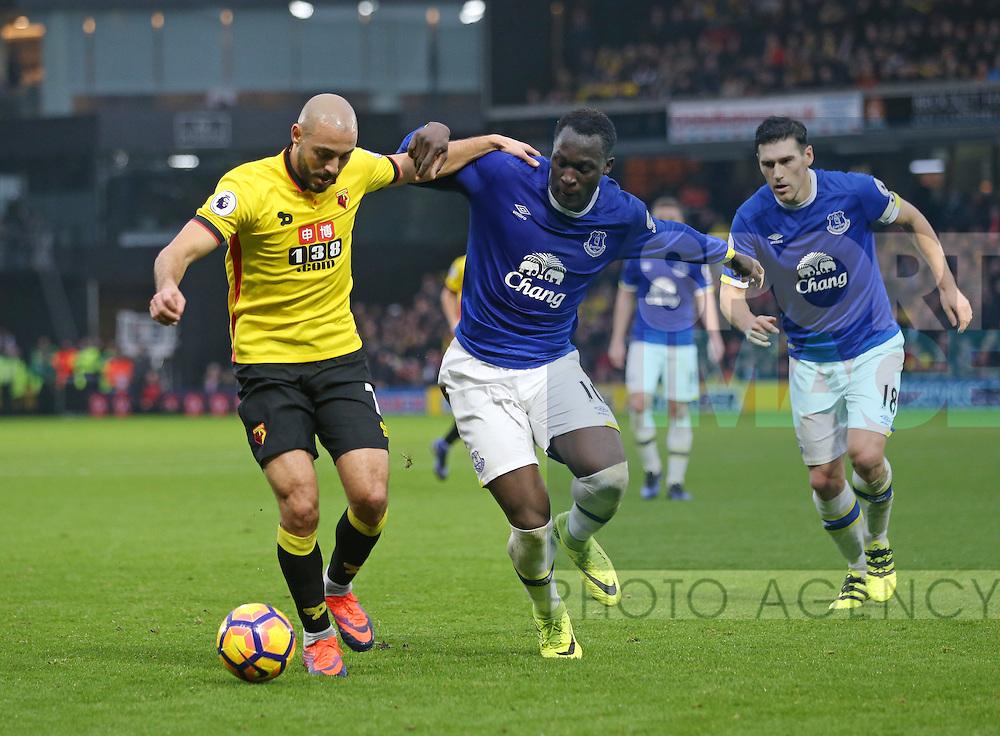 Watford's Nordin Amrabat tussles with Everton's Romelu Lukaku during the Premier League match at Vicarage Road Stadium, London. Picture date December 10th, 2016 Pic David Klein/Sportimage