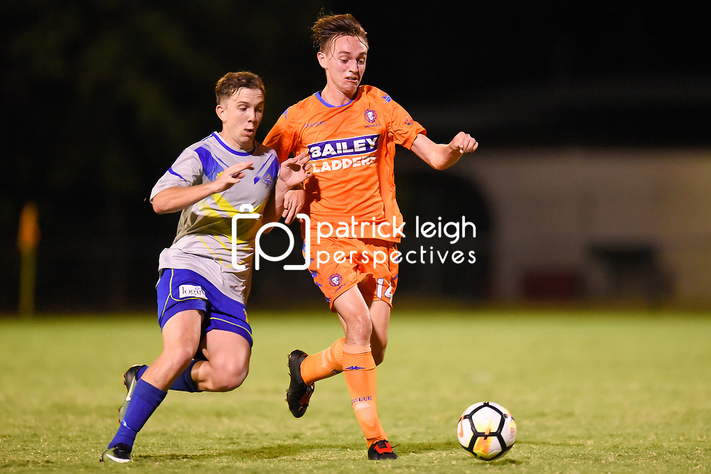 BRISBANE, AUSTRALIA - JANUARY 27: Liam Cosgrove of Lions and Ryan Palmer of the Strikers compete for the ball during the Kappa Silver Boot Grand Final match between Lions FC and Brisbane Strikers on January 27, 2018 in Brisbane, Australia. (Photo by Patrick Kearney)