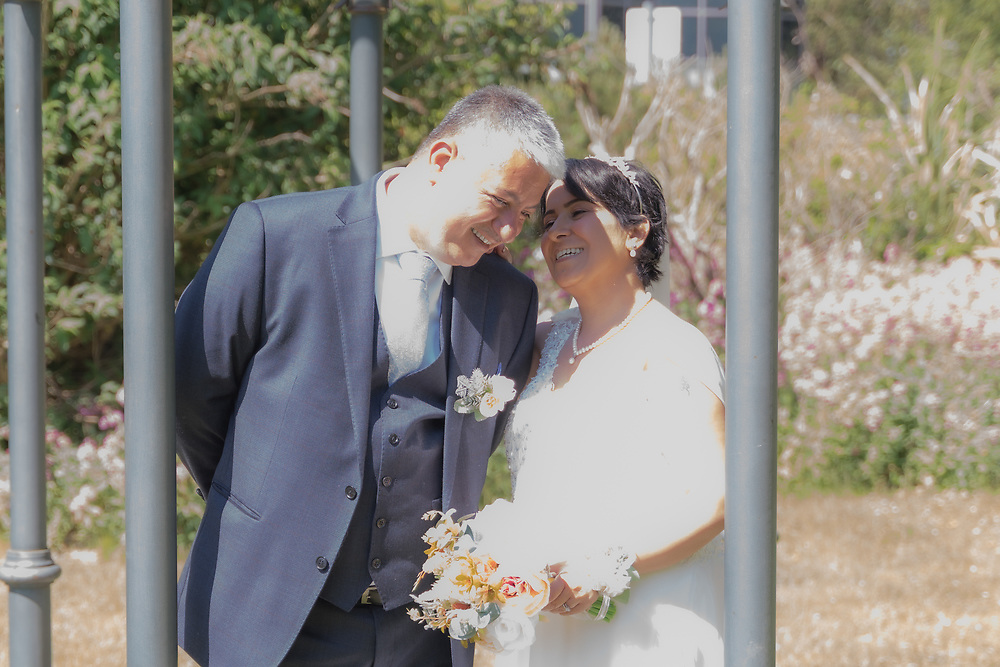 Wedding couple in gardens of Leonardo Royal Southampton Grand Harbour