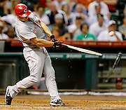 July 24, 2012; Houston, TX, USA; Cincinnati Reds left fielder Chris Heisey (28) breaks his bat as he grounds out against the Houston Astros during the eighth inning at Minute Maid Park. Mandatory Credit: Thomas Campbell-US PRESSWIRE
