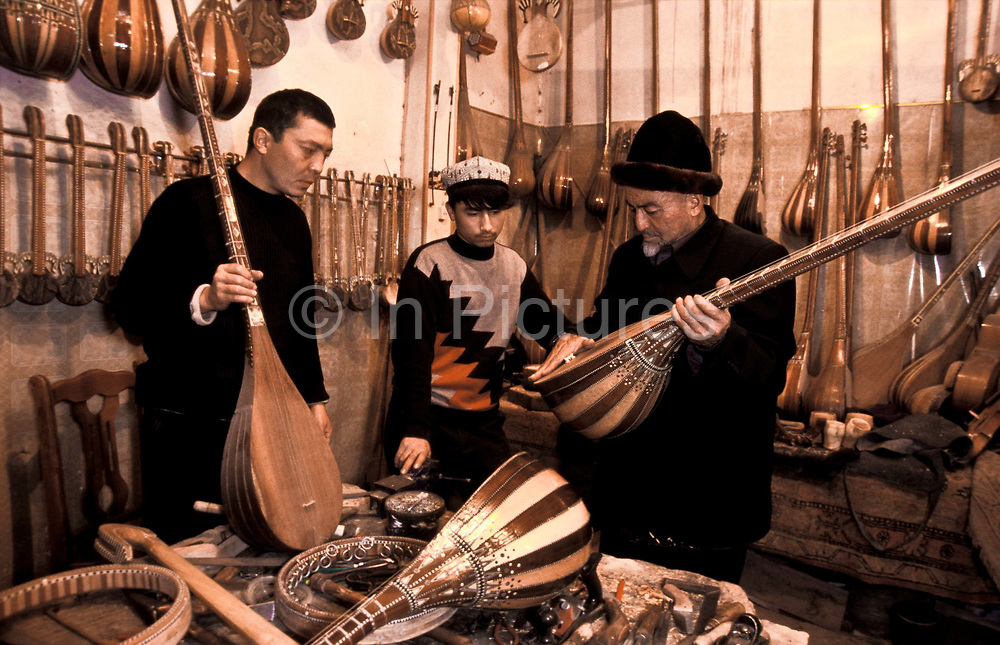 Ababakri Selay, 80 and son, Muhammad Turson, 40 are Uighurs of Turkic origin, they make  over 40 varieties of instruments in ther workshop: Rawap, Duttar, Tanbur, Huxtar, Gijek and many others, including those of  their own creation. Five generations have been involved in this traditional instrument making. These five generations have lived through Chinese imperial rule, Russian influence, civil war, and back to chinese rule. Amidst all this they have continued to make music and instruments and sold them throughout the Muslim region they inhabit.  They are the principal instrument makers in the city, an institution in their own right and highly respected, Kashgar city, China