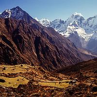 Thamserku and Kangtega peaks with a yak-herding village on the shoulder of Khumbila peak