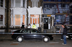 © licensed to London News Pictures. 29/06/2011. London, UK. Police  at the scene where dismembered human body part, believed to be a head, was found in a West London garden last night (28/06/2011). Officers search the basement of a property in West Kensington where the body part was believed to have been found. See special instructions . Photo credit should read Cliff Hide/LNP