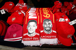 Arsenal scarves for sale featuring Mesut Ozil and Alexandre Lacazette during the Premier League match at The Emirates Stadium, London.