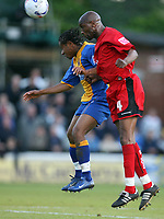 Photo: Rich Eaton.<br /> <br /> Shrewsbury Town v Milton Keynes Dons. Coca Cola League 2. Play off Semi Final, 1st Leg. 14/05/2007. Shrewsburys Derek Asamoah left jumps for the ball ahead of MK Dons Drissa Diallo
