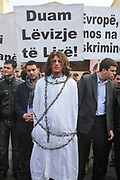 An ethnic Albanian actor wrapped in a chain is protesting with several other supporters against the European Union's visa regime against Kosovo citizens in capital Pristina on Feb 15, 2011. Protests against the EU visa regime are mounting as the EU decides to allow the free movement of citizens of the Western Balkans, excluding Kosovo. (Photo/ Vudi Xhymshiti)